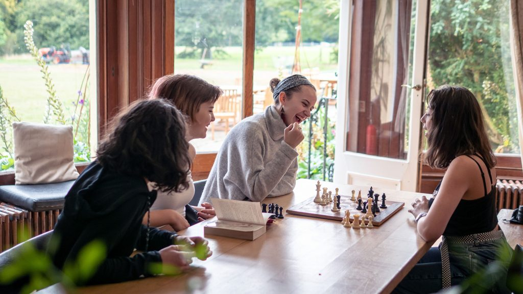 Students playing chess at Brockwood Park School