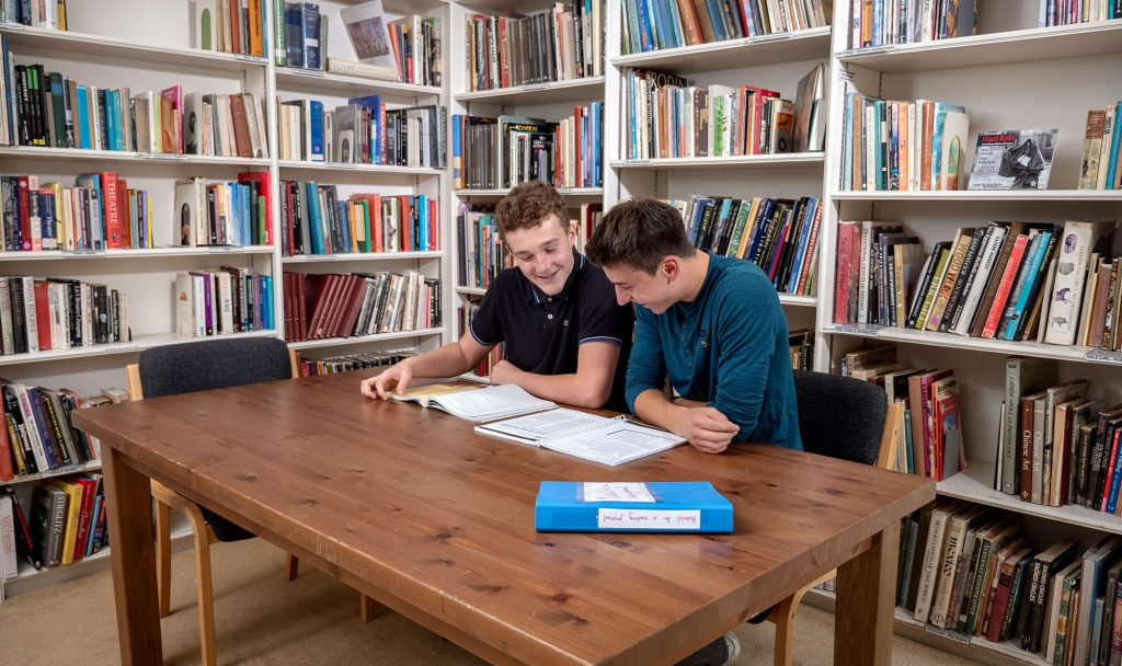 Students studying together in the library at Brockwood Park School