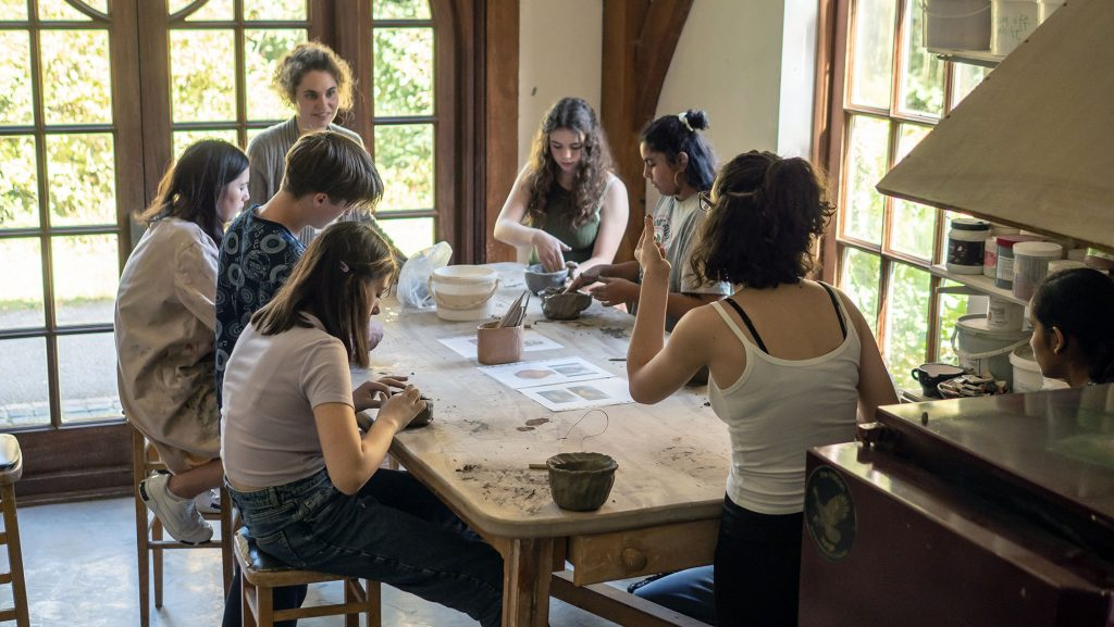 Students doing pottery in the Art Barn at Brockwood Park School