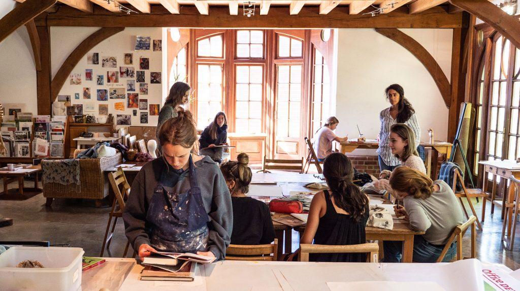 Students in the Art Barn at Brockwood Park School