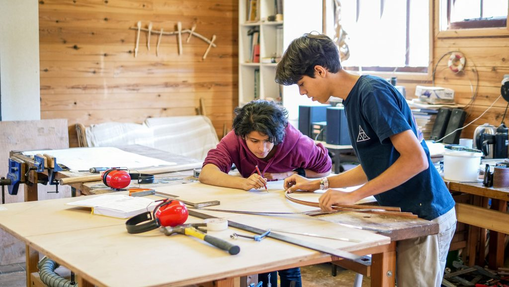 Students in the woodwork barn at Brockwood Park School