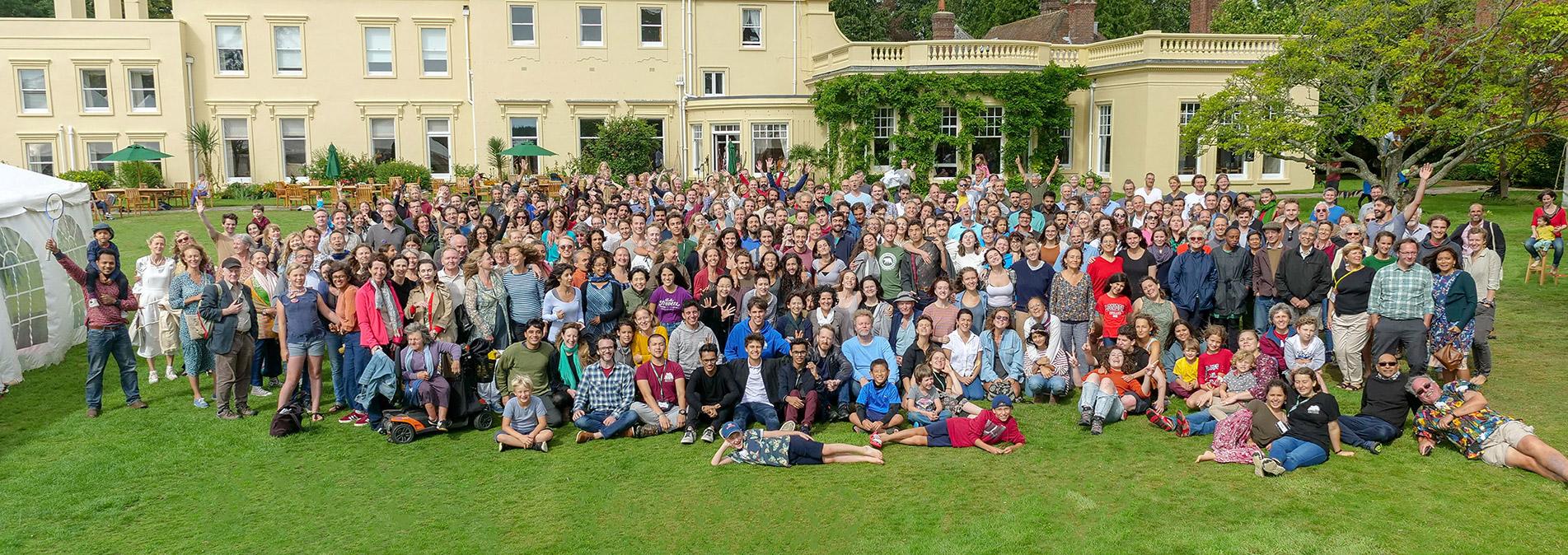 Group photo of hundreds of alumni gathering at Brockwood Park School