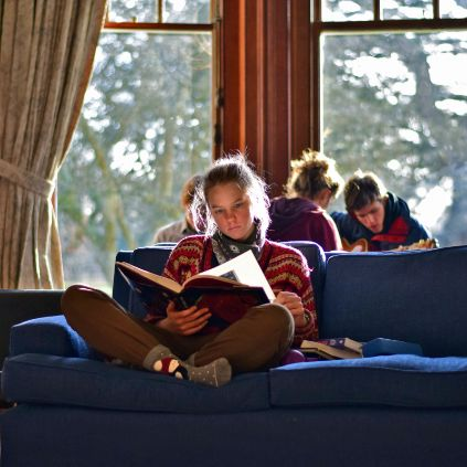 Brockwood Park School - Knowledge - A student reading a book