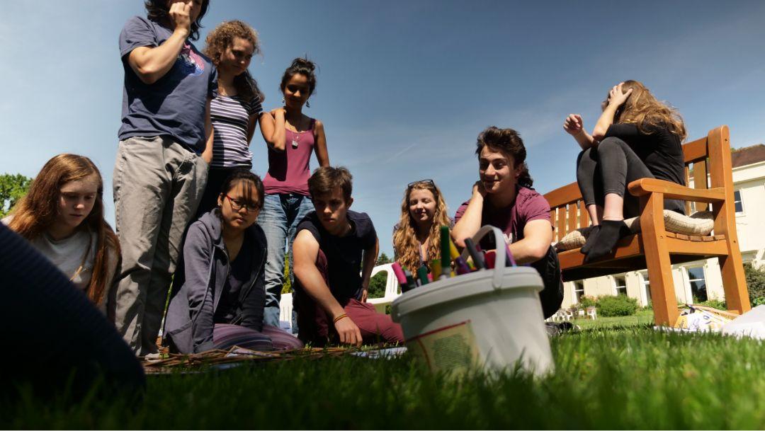 Brockwood Park School sitting together outdoors