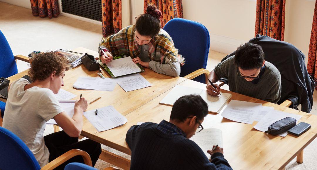Brockwood Park School students focussing on studying together